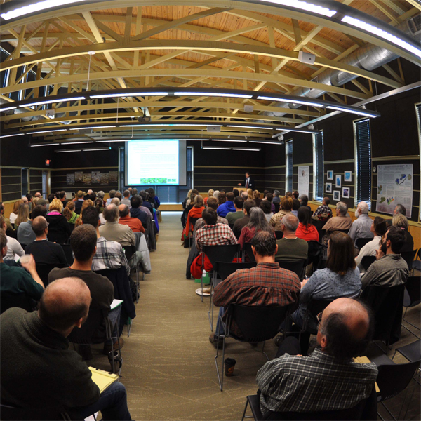 A full lecture hall hears Keynote Speaker Rob Naczi speak at Powdermill Nature Preserve